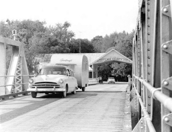 Car and trailer crossing a bridge - Astor, Florida, 1957